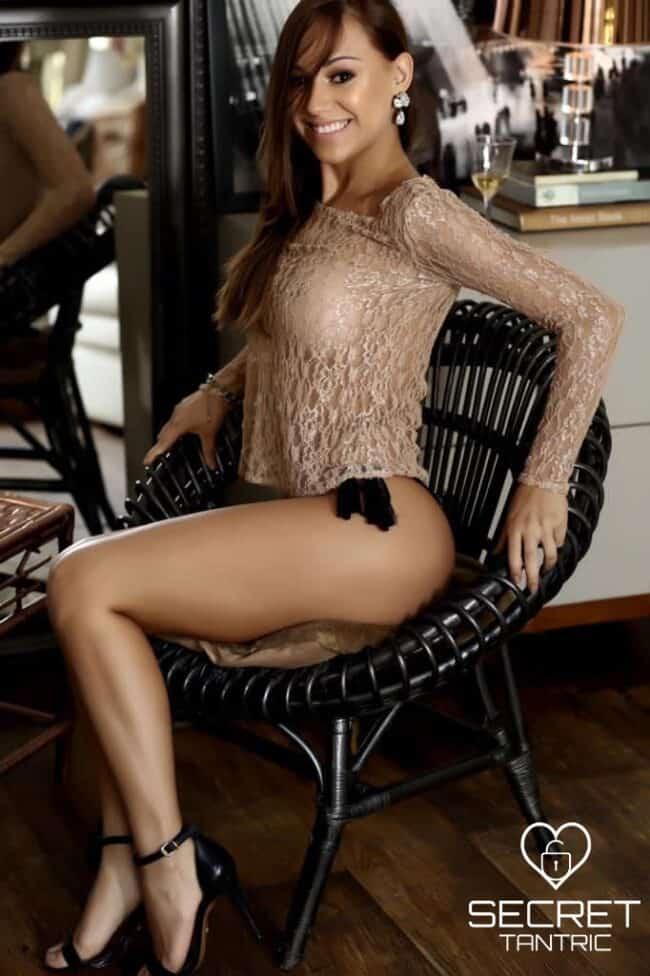 Girl posing sitting on chair