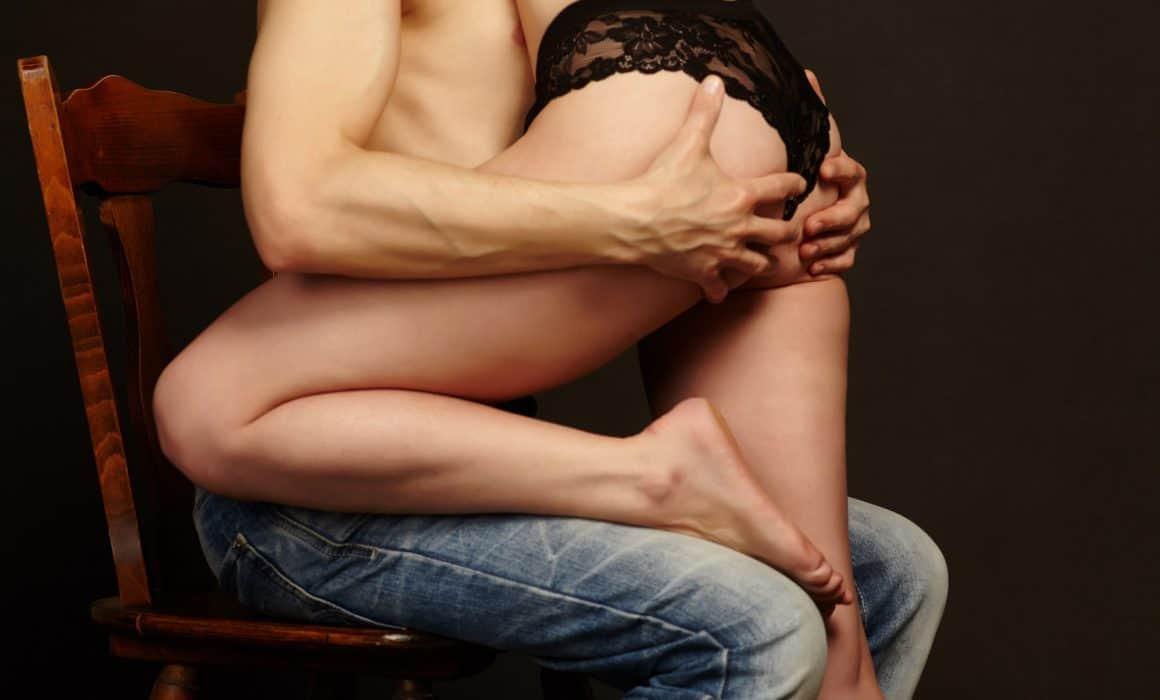 Boy holding girl butt