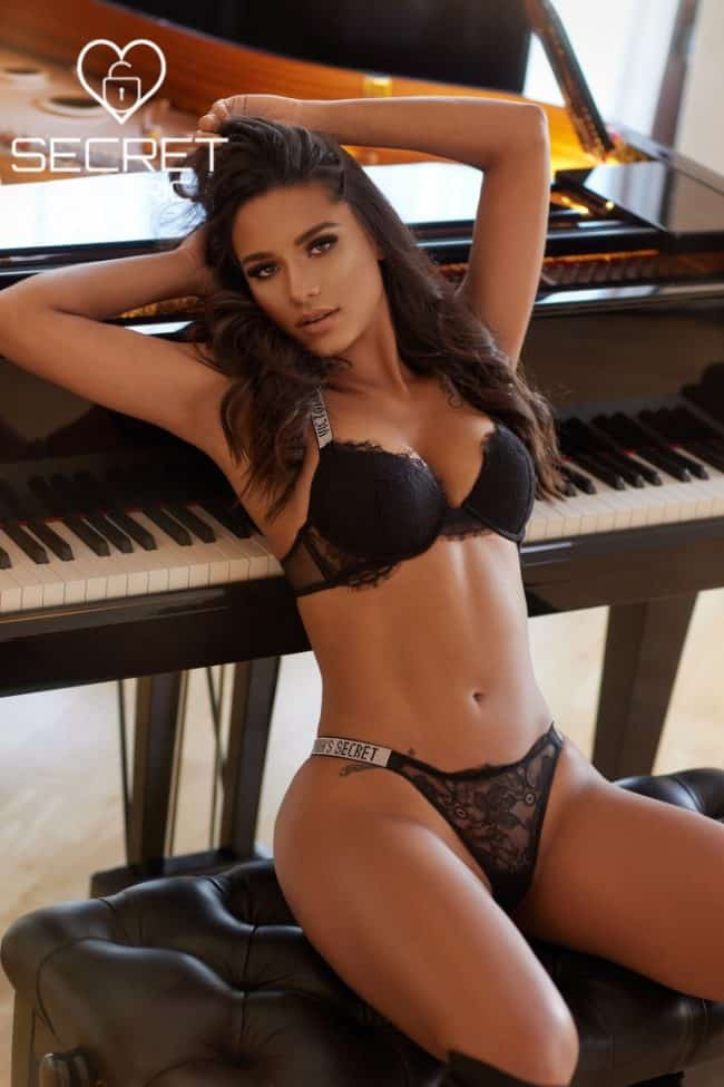Louisa - Erotic Masseuse in black lingerie playing with her hair| Secret Tantric London