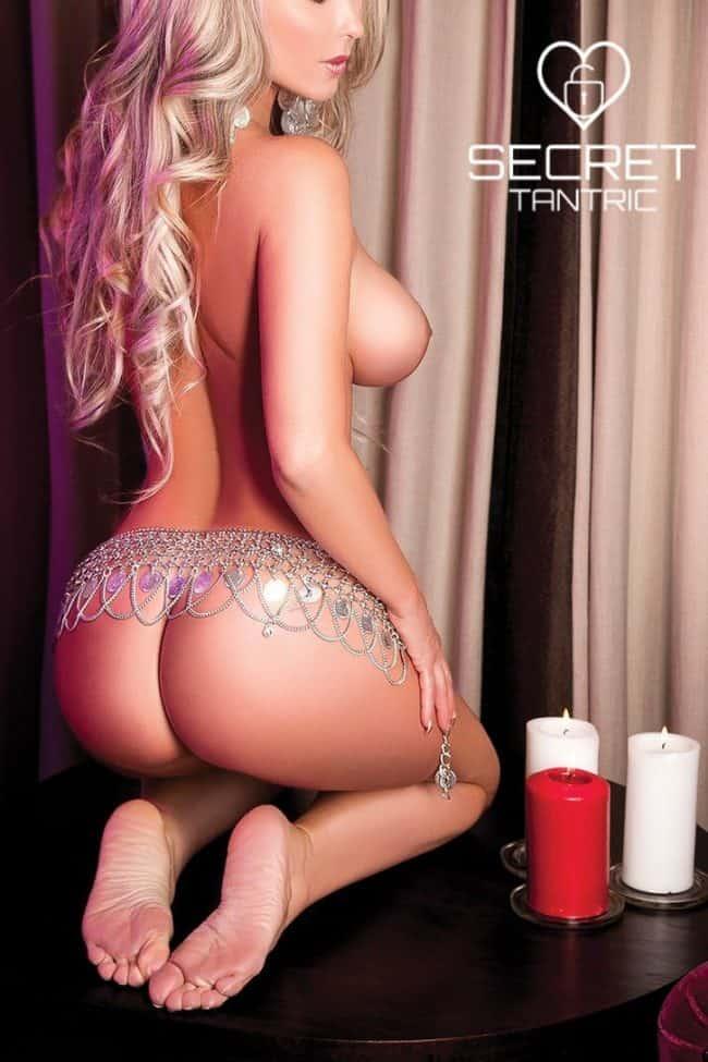 Voluptuous tantric masseuse kneeling by candles | Beatriz Secret Tantric London
